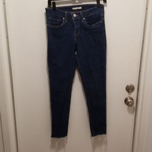 Levi's 711 Skinny Jeans with frayed ankles